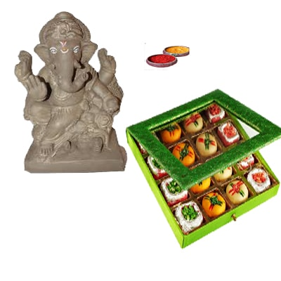 Ganesh idol with dood peda sweet