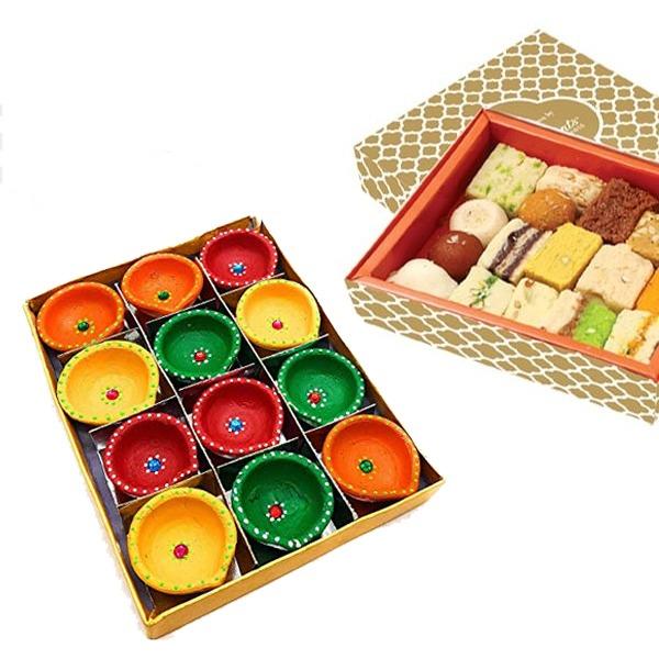 Colorful diyas with Sweet box